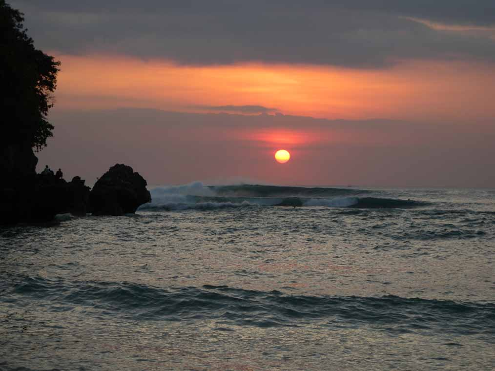 Surfing the big sets at sunset, Padang Padang